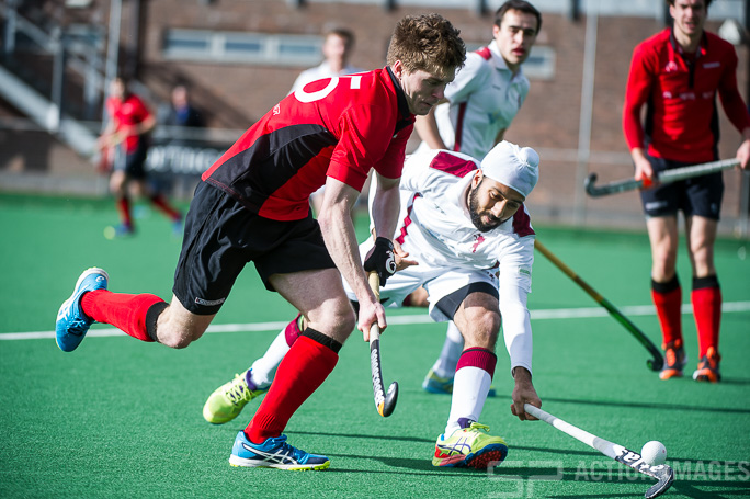 Southgate's Adam Miller beats Bhamra Gormurh of Richmond. Southgate v Richmond - Men's Hockey League - East Conference, Trent Park, London, UK on 05 March 2017. Photo: Simon Parker