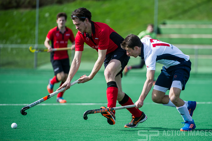 Southgate's Joe Bradley is watched by Al Carter of Brighton. Southgate v Brighton & Hove - Men's Hockey League - East Conference, Trent Park, London, UK on 26 March 2017. Photo: Simon Parker